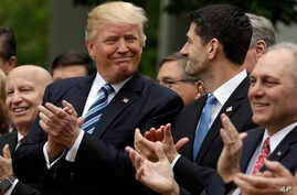President Donald Trump talks with House Speaker Paul Ryan of Wis., in the Rose Garden of the White House in Washington, May 4, 2017, after the House pushed through a health care bill.