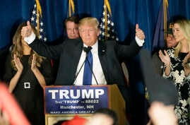 Republican presidential candidate, businessman Donald Trump gives thumbs up to supporters during a primary night rally, Tuesday, Feb. 9, 2016.