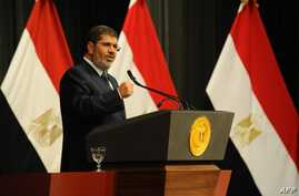Egyptian President Mohammed Morsi addresses conference June 26, 2013 in Cairo (Egyptian Presidency photo)