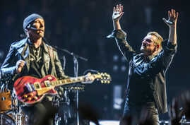 FILE - Bono (R) and The Edge of U2 are seen performing at the Innocence + Experience Tour at The Forum, in Inglewood, California, May 26, 2015.