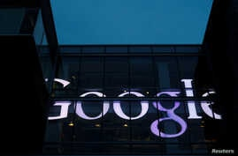 The sign marking the Google offices is lit up in Cambridge, Massachusetts, U.S., June 27, 2017.