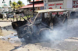 A burning vehicle which was set on fire by protesting Muslim youths after Islamic cleric Aboud Rogo Mohammed was killed in Mombasa, Kenya, Aug. 27, 2012.