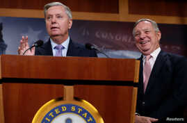 "U.S. Sen. Lindsey Graham, R-S.C., flanked by Sen. Dick Durbin, D-Ill., talks about legislation for so-called ""dreamer"" immigrant children during a news conference at the U.S. Capitol in Washington, July 20, 2017."