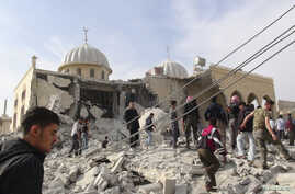 Residents and members of the Free Syrian Army inspect Bilal mosque, which activists said was damaged after it was fired upon by a Syrian Air Force fighter jet loyal to Syria's President Bashar al-Assad, at Marat al-Numan near the northern province of