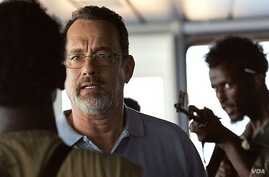 """Tom Hanks is seen in a scene from the movie """"Captain Phillips."""" A new study says gun violence in PG-13 movies has tripled since 1985. (Sony Pictures)"""