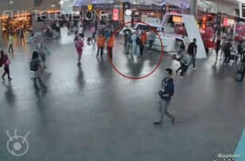 A still image from a CCTV footage appears to show a man purported to be Kim Jong Nam (circled in red) talking to airport staff, after being accosted by a woman in a white shirt, at Kuala Lumpur International Airport in Malaysia, Feb. 13, 2017.