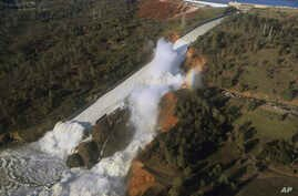 Feb 11 aerial photo released by the California Department of Water Resources shows the damaged spillway with eroded hillside in Oroville, Calif.