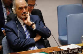 United Nations Ambassador from Syria Bashar Ja'afari listens during a meeting of the U.N. Security Council, April 9, 2018, at U.N. headquarters.