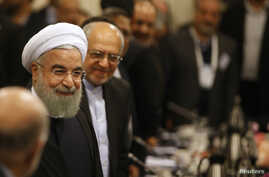 Iran's President Hassan Rouhani arrives to attend a meeting with French business leaders and politicians at a hotel in Paris, France, Jan. 27, 2016.