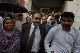 Tahir Naveed Chaudhry, center, lawyer of Christian girl accused of blasphemy, leaves after court hearing in Islamabad, Pakistan, Sept. 3, 2012.