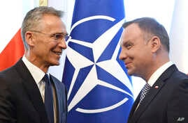 NATO Secretary General Jens Stoltenberg (L) shakes hands with Polish President Andrzej Duda prior to talks in Warsaw, Poland, May 28, 2018.