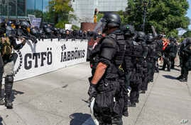 "Portland police keep Patriot Prayer affiliates separate from antifa protesters during a rally in Portland, Ore., Saturday, Aug. 4, 2018.Small scuffles broke out Saturday as police in Portland, Oregon, deployed ""flash bang"" devices and other means to"