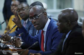 Haiti's Minister of Planning and External Cooperation Aviol Fleurant gestures as he speaks during a news conference about the resolution on the Oxfam scandal in Port-au-Prince, Haiti, June 13, 2018.