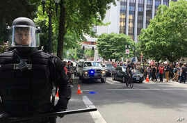 FILE - Thousands of protesters gather in Portland, Ore., for competing rallies following last month's fatal stabbing of two men on a light-rail train by a man police say was shouting anti-Muslim slurs. Marches against Islamic law are scheduled in mor