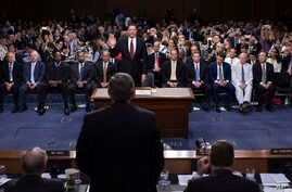 Former FBI Director James Comey is sworn in during a Senate Intelligence Committee hearing on Capitol Hill, June 8, 2017, in Washington