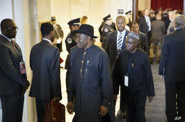 Nigeria's President Goodluck Jonathan, center, departs a reception for leaders attending the US-Africa Summit on Capitol Hill in Washington, Monday, Aug. 4, 2014.