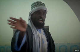 FILE - Photo made from Boko Haram video released by the Nigerian Islamist extremist group Boko Haram and obtained by AFP shows the leader of the Nigerian Islamist extremist group Boko Haram, Abubakar Shekau preaching to locals in an unidentified town...