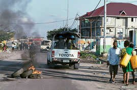 Peacekeepers serving in the United Nations Organization Stabilization Mission in the Democratic Republic of the Congo (MONUSCO) drive past burning tyres as they patrol during protests against President Joseph Kabila in the streets of the Democratic R