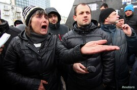 Pro-Russian supporters take part in a rally outside the regional administration in Donetsk, March 17, 2014.