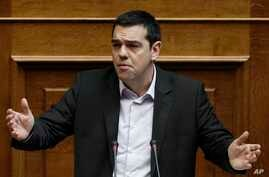 Greek Prime Minister Alexis Tsipras speaks in parliament before the vote of an anti-poverty bill, the first piece of legislation from the left-wing government, in Athens, March 18, 2015.