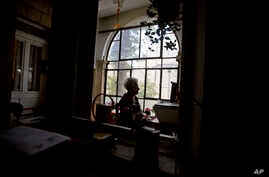 FILE - In this Jan. 20, 2016, photo, Dutch Israeli holocaust survivor Mirjam Bolle is seen in her house in Jerusalem. Throughout the Nazi occupation of Amsterdam, and while incarcerated in two prison camps, Bolle wrote letters to her fiance that she