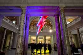 """A neon flash representing David Bowie's """"Aladdin Sane"""" stage character is seen at the entrance to the Victoria and Albert Museum to mark the """"David Bowie is"""" exhibition in London, March 20, 2013."""