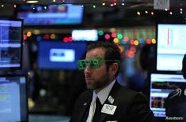 "A trader wears a pair of ""2017"" glasses in anticipation of the New Year at the New York Stock Exchange in Manhattan, New York, Dec. 30, 2016."