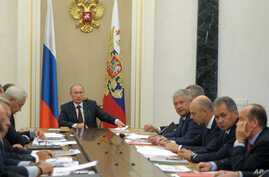 Russian President Vladimir Putin chairs a meeting on weapons modernization plans in the Kremlin in Moscow, Russia, Sept. 10, 2014.