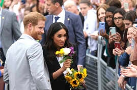 Britain's Prince Harry and Meghan, the Duchess of Sussex, meet members of the public at Trinity College, on the second day of their visit to Dublin, Ireland, July 11, 2018.
