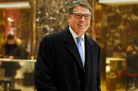 FILE - Former Texas Gov. Rick Perry smiles as he leaves Trump Tower in New York, Dec. 12, 2016. President-elect Donald Trump selected Perry to be secretary of energy, Wednesday, Dec, 14, 2016.