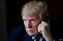 President Donald Trump talks with troops via teleconference from his Mar-a-Lago estate in Palm Beach, Fla., Nov. 22, 2018.
