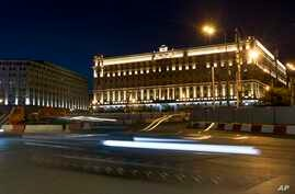 In this photo taken July 24, 2017, a car passes the building of the Federal Security Service (FSB, Soviet KGB successor) in Lubyanskaya Square in Moscow, Russia. The U.S. has orchestrated the arrest of five alleged Russian cybercriminals across Europ