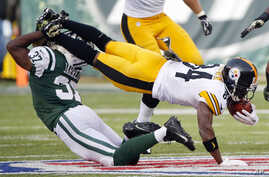 New York Jets free safety Jaiquawn Jarrett (37) tackles Pittsburgh Steelers' Antonio Brown (84) during the first half of an NFL football game in East Rutherford, N.J., Sunday.