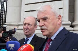 Independent Alliance Ministers, Shane Ross (L) and Finian McGrath speak to the press on arrival at Government buildings for a cabinet meeting in Dublin on Sept. 2, 2016 on whether to appeal an EU order mandating Ireland to collect €13 billion in taxe