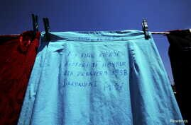 """A skirt, which reads: """"This skirt has a closed history since Spring 1998. Dardania-Peja"""", is pictured at an art installation of women dresses, named """"Thinking of You"""" by Kosovo-born, London-based artist Alketa Mrripa-Xhafa, in Pristina, Kosovo, June"""
