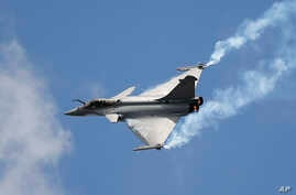 FILE - A Rafale fighter jet is seen during a demonstration flight at the Paris Air Show, in Le Bourget, north of Paris, June 19, 2015. India on Friday signed a $8.7 billion deal with France to buy 36 of them.