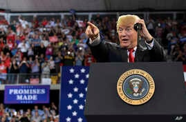 President Donald Trump speaks at a rally at AMSOIL Arena in Duluth, Minn., June 20, 2018.