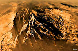 Titan is seen from the Huygens probe as it descended to the surface in 2005.