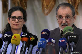 FILE - Ilham Ahmed and Riad Darar co-chair's of the Syrian Democratic Council (SDC) are seen during the third meeting in Tabqa, Syria July 16, 2018.