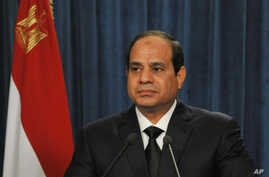 President Abdel-Fattah el-Sissi makes a statement after militants in Libya affiliated with the Islamic State group released a grisly video showing the beheading of several Egyptian Coptic Christians, in this image released by the Egyptian Presidency,
