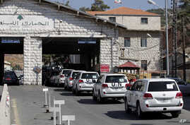 A convoy of inspectors from the Organization for the Prohibition of Chemical Weapons prepares cross into Syria at the Lebanese border crossing point of Masnaa, Oct. 1, 2013.