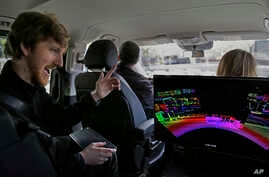 In this photograph taken on April 10, 2017, Luminar CEO Austin Russell gestures while looking at a 3D lidar map on a demonstration drive in San Francisco.