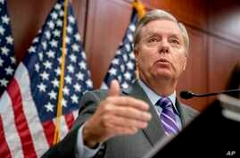 "FILE - Sen. Lindsey Graham, R-S.C., speaks during a news conference on Capitol Hill, Dec. 6, 2017, in Washington. Graham on Jan. 16, 2018, urged President Donald Trump to ""close this deal"" on immigration reform."
