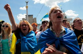 People shout slogans during a rally in Independence Square in Kyiv, Ukraine, June 29, 2014.