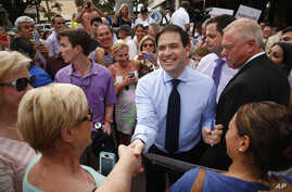 In this March 11, 2016, photo, Republican presidential candidate, Sen. Marco Rubio, R-Fla. greets supporters in Naples, Fla.