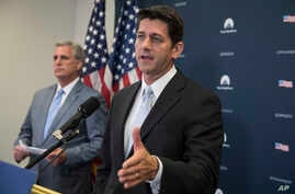 House Speaker Paul Ryan of Wisconsin, joined by House Majority Leader Kevin McCarthy of California, meets with reporters during a news conference on Capitol Hill in Washington, July 12, 2017.