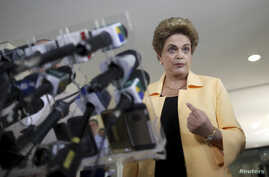 President Dilma Rousseff addresses a news conference after visiting the new Embraer KC 390 military transport aircraft in Brasilia, Brazil, April 5, 2016.