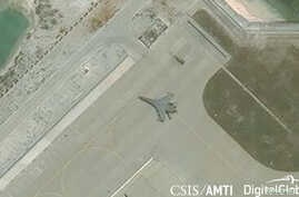 FILE - Satellite imagery shows what the CSIS Asia Maritime Transparency Initiative describes as the deployment of several new weapons systems, including a J-11 combat aircraft, at China's base on Woody Island in the Paracels, South China Sea, May 12,