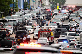 Police respond to reports of a shooting and subsequent lockdown at the U.S. Navy Yard in Washington, July 2, 2015.