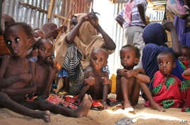 FILE - Malnourished and displaced Somali children sit in a tent in their camp on the outskirts of Mogadishu, Somalia, May 25, 2017.